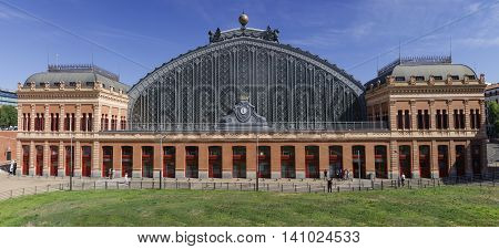 Madrid Spain July 11 2016: View of the Atocha train station building in Madrid a sunny day. Panoramic shot
