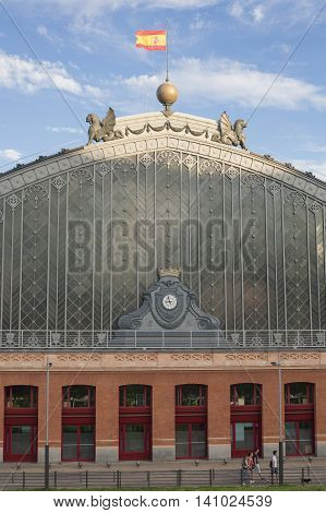 Madrid Spain July 11 2016: View of the Atocha train station building in Madrid a sunny day