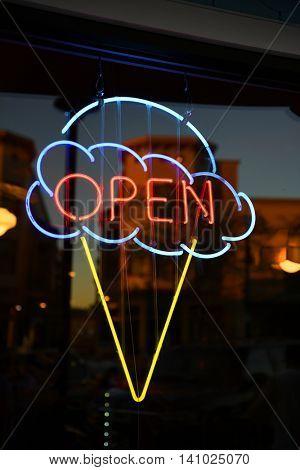 Open ice cream neon sign on window