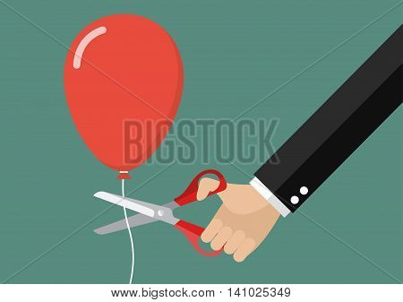 Big hand cutting balloon string with scissors. Business concept