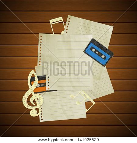 Musical background paper treble clef with music notes audio cassettes and blank paper pages on wooden boards. There is a place to put any text or image.