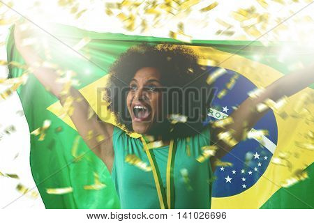 Brazilian young female fan celebrating