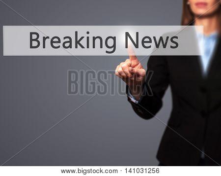 Breaking News - Businesswoman Pressing Modern  Buttons On A Virtual Screen