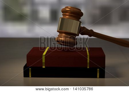 3D rendering of a judge hamer and books on a wooden table