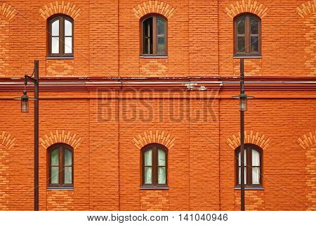Red Brick Wall Facade With Six Arched Windows