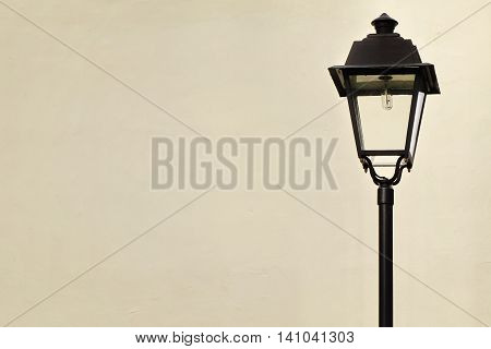 Garden Or Street Lamp Post In Victorian Style And White Wall In The Background