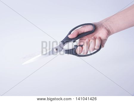 Scissors. Scissors With Hand On Background. Scissors On A Background.