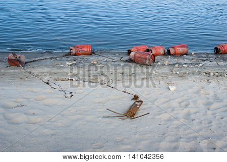 Buoys laid out on the sandy banks of the Volga