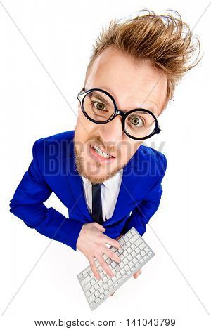 Funny smart businessman in spectacles looking at camera. Programmer. Isolated over white.