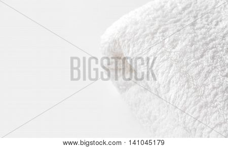 White terry towel on the light cream background at the right