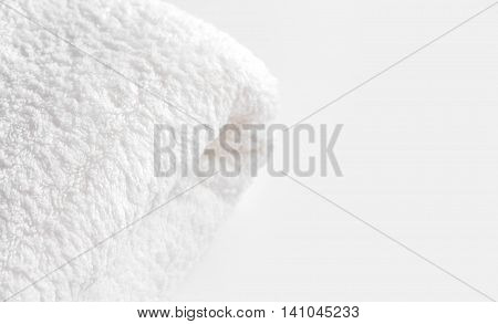 White terry towel on the light cream background at the left