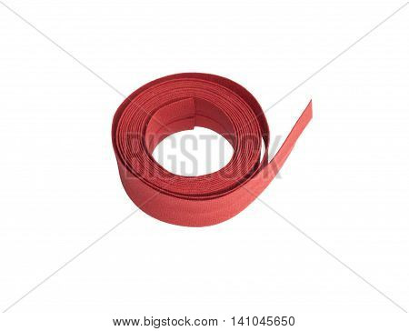 Bias binding, red mat seam binding isolated on white background.