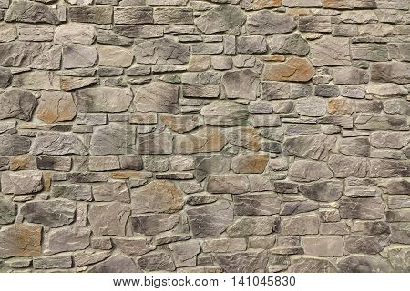 Modern Textured Stonewall Made From Flagstone And Sandstone Slabs Background