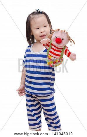 Little asian girl playing with puppet over white