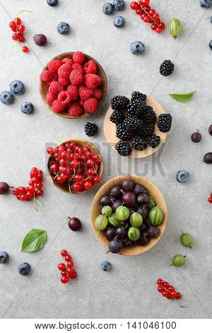 Mixed Fresh Ripe Berries In Bow On Slate Background