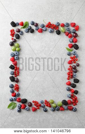 Mixed Berries Shaped As A Frame On Slate Background