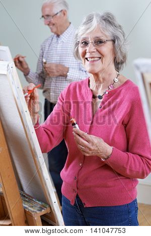 Portrait Of Seniors Attending Painting Class Together