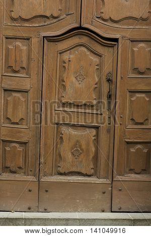 Old wooden and crooked door in Montechiaro d'Acqui Piedmonte Italy