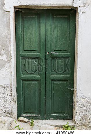 Old green wooden door in Montechiaro d'Acqui Piedmonte Italy