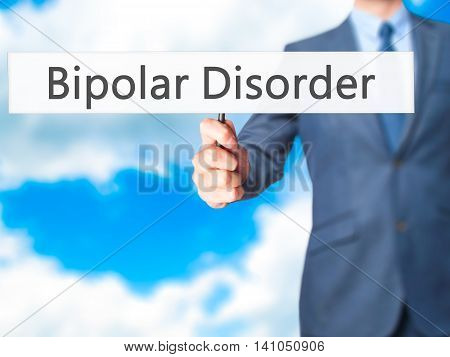 Bipolar Disorder - Businessman Hand Holding Sign