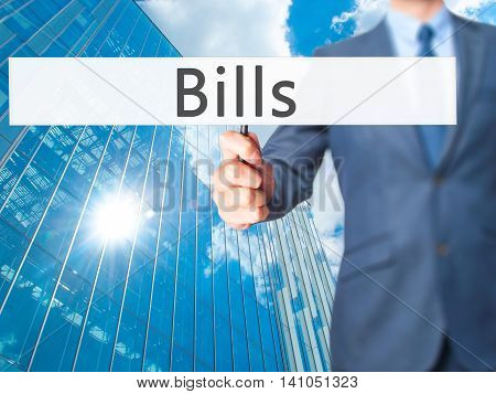 Bills - Businessman Hand Holding Sign