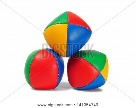 Pyramid of three juggling balls on white background