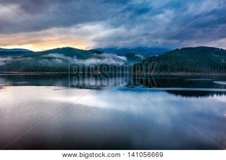 Lake Oasa At Sunset In Romania
