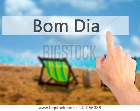 Bom Dia (in Portuguese - Good Morning) - Hand Pressing A Button On Blurred Background Concept On Vis