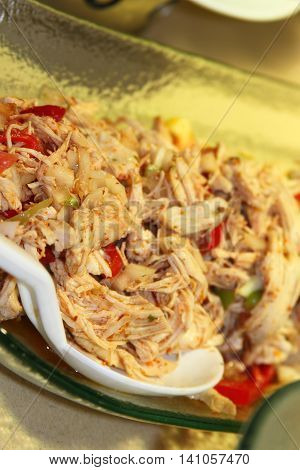 Meat salad with chicken and vegetables on a plate