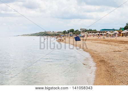 Tourists On Sand And Shelly Beach Sea Of Azov