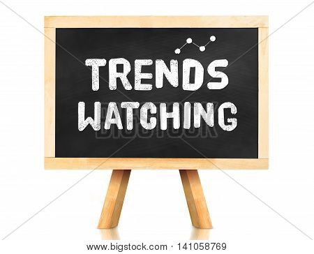 Blackboard With Trend Watching Word And Icon On White Background ,business Concept