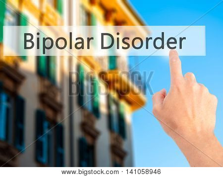 Bipolar Disorder - Hand Pressing A Button On Blurred Background Concept On Visual Screen.