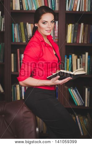 Attractive Business Woman In Office Attire Standing Against The