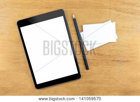 Digital Tablet Computer With Empty Screen,business Card And Black Pencil On Wooden Table, Mock Up Fo