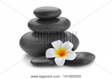 zen basalt stones and Frangipani isolated on white