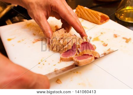 Cook cut with knife medium fried tuna slices starters