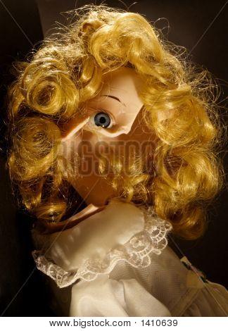 Broken Doll Sitting