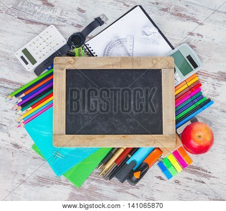 Empty Chalkboard hero header with copy space and school supplies