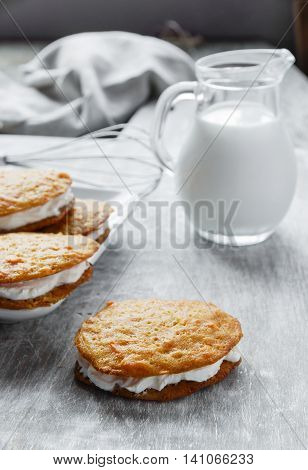 cream filled carrot cake cookies sandwich on board