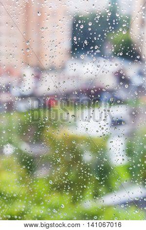 Rain Drops On Window And Blurred Cityscape