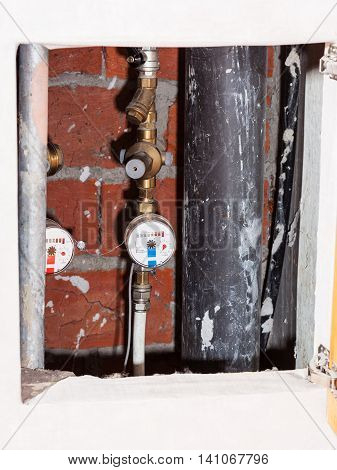 Residential Water Meters On Pipes In Niche