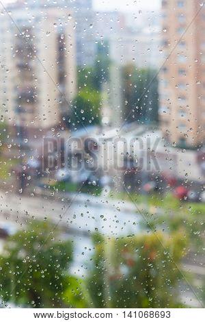 Rain Drops On Window Glass And Blurred Street