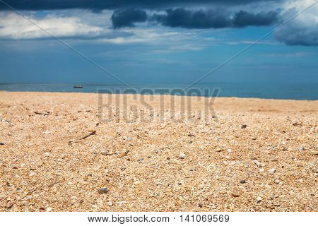 Scenery With Sand Beach And Dark Blue Rain Clouds