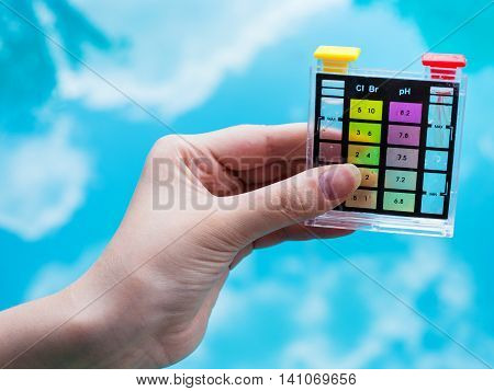 Checking Ph Level In Blue Outdoor Pool