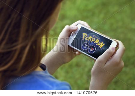 Vienna, AUSTRIA - August 1, 2016: Pokemon Go logo on the phone. Pokemon Go is a location-based augmented reality mobile game.