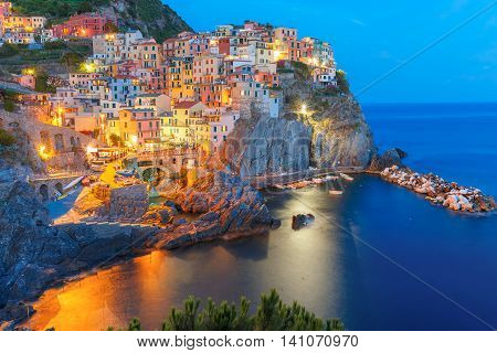 Aerial night view of Manarola fishing village, seascape in Five lands, Cinque Terre National Park, Liguria, Italy.