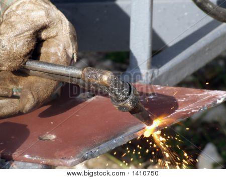 Welder Welding At A Construction Site