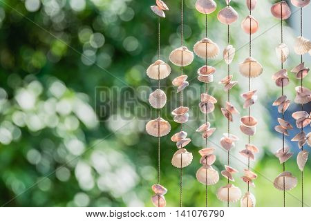 Hanging seashells chime together with every gentle breeze, making a soft, soothing music.shells mobiles curtain showcases the subtle, pearly hues of your seaside souvenirs from the seaside