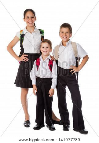 Three happy students with rucksacks standing together, isolated on white