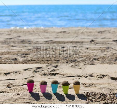 Toy Ice Cream Cones On The Beach With Sand